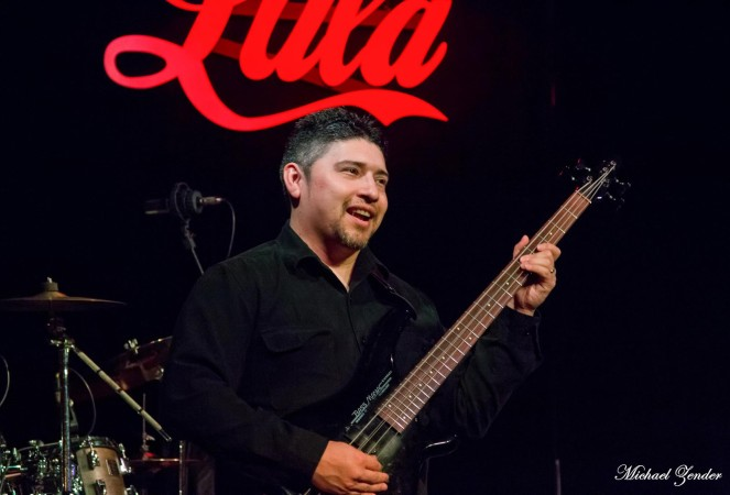 Photo of Cristian playing bass.
