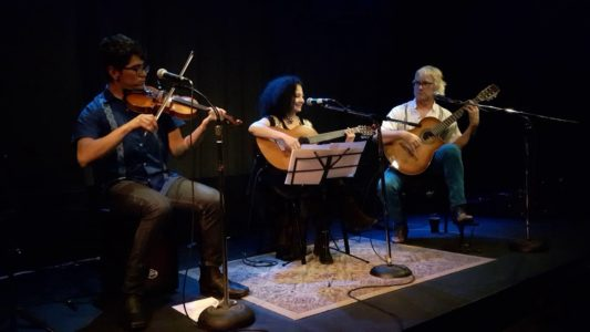Photo by Andrew McPherson: Alex, Rosy and Richard on the stage at Artword Artbar, Hamilton